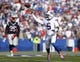 Sep 20, 2015; Orchard Park, NY, USA; Buffalo Bills quarterback Tyrod Taylor (5) throws a pass during the second half against the New England Patriots at Ralph Wilson Stadium. Patriots beat the Bills 40-32. Mandatory Credit: Kevin Hoffman-USA TODAY Sports
