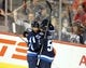 Oct 1, 2015; Winnipeg, Manitoba, CAN; Winnipeg Jets  defenceman  Ben Chariot (7) celebrates with forward  Mark Scheifele (55) after scoring his second goal of the game during the second periodagainst the Calgary Flames at MTS Centre. Mandatory Credit: Bruce Fedyck-USA TODAY Sports