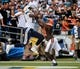 Oct 4, 2015; San Diego, CA, USA;  San Diego Chargers tight end Ladarius Green (89) leaps over Cleveland Browns strong safety Donte Whitner (31) for a 19-yard touchdown in the third quarter at Qualcomm Stadium. The Chargers went on to a 30-17 win. Mandatory Credit: Robert Hanashiro-USA TODAY Sports