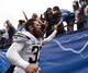 Oct 4, 2015; San Diego, CA, USA; San Diego Chargers free safety Eric Weddle (32) celebrates with fans as he runs to the locker room after the Chargers beat the Cleveland Browns 30-27 at Qualcomm Stadium. Mandatory Credit: Robert Hanashiro-USA TODAY Sports