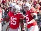 Oct 10, 2015; Columbus, OH, USA; Ohio State Buckeyes running back Ezekiel Elliott (15) is congratulated by quarterback J.T. Barrett (16) and offensive lineman Pat Elflein (65) after his touchdown against the Maryland Terrapins at Ohio Stadium. Mandatory Credit: Greg Bartram-USA TODAY Sports