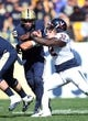 Oct 10, 2015; Pittsburgh, PA, USA; Pittsburgh Panthers quarterback Chad Voytik (16) rushes the ball as Virginia Cavaliers defensive end Mike Moore (32) defends during the first quarter at Heinz Field. Mandatory Credit: Charles LeClaire-USA TODAY Sports