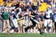 Oct 10, 2015; Pittsburgh, PA, USA; Pittsburgh Panthers tight end J.P. Holtz (86) runs after a catch against Virginia Cavaliers cornerback Maurice Canady (26) during the first quarter at Heinz Field. Mandatory Credit: Charles LeClaire-USA TODAY Sports