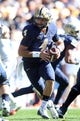 Oct 10, 2015; Pittsburgh, PA, USA; Pittsburgh Panthers quarterback Nathan Peterman (4) scrambles with the ball against the Virginia Cavaliers during the first quarter at Heinz Field. Mandatory Credit: Charles LeClaire-USA TODAY Sports