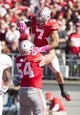 Oct 10, 2015; Columbus, OH, USA; Ohio State Buckeyes wide receiver Jalin Marshall (7) is congratulated by offensive lineman Billy Price (54) after scoring a touchdown against the Maryland Terrapins at Ohio Stadium. Mandatory Credit: Greg Bartram-USA TODAY Sports