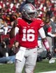 Oct 10, 2015; Columbus, OH, USA; Ohio State Buckeyes quarterback J.T. Barrett (16) celebrates after scoring against the Maryland Terrapins at Ohio Stadium. Ohio State won the game 49-28. Mandatory Credit: Greg Bartram-USA TODAY Sports