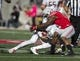 Oct 10, 2015; Columbus, OH, USA; Maryland Terrapins quarterback Perry Hills (11) collides with Ohio State Buckeyes safety Vonn Bell (11) at Ohio Stadium. Ohio State won the game 49-28. Mandatory Credit: Greg Bartram-USA TODAY Sports