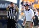Oct 10, 2015; Pittsburgh, PA, USA; Pittsburgh Panthers head coach Pat Narduzzi (right) reacts as line judge Allen Andrick (left) signals a Virginia Cavaliers first down during the third quarter at Heinz Field. PITT won 26-19. Mandatory Credit: Charles LeClaire-USA TODAY Sports