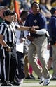Oct 10, 2015; Toledo, OH, USA; Kent State Golden Flashes head coach Paul Haynes gets held back by an official during the first quarter against the Toledo Rockets at Glass Bowl. Mandatory Credit: Raj Mehta-USA TODAY Sports