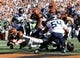 Oct 11, 2015; Cincinnati, OH, USA; Cincinnati Bengals quarterback Andy Dalton (14) dives into the end zone for a touchdown in the second half against the Seattle Seahawks at Paul Brown Stadium. The Bengals won 27-24. Mandatory Credit: Aaron Doster-USA TODAY Sports