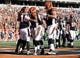 Oct 11, 2015; Cincinnati, OH, USA; Cincinnati Bengals quarterback Andy Dalton (14) celebrates with teammates after scoring a touchdown in the second half against the Seattle Seahawks at Paul Brown Stadium. The Bengals won 27-24. Mandatory Credit: Aaron Doster-USA TODAY Sports