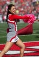 Oct 10, 2015; Columbus, OH, USA; A member of the Ohio State Buckeyes cheerleading squad entertains the fans during the game against the Maryland Terrapins at Ohio Stadium. Ohio State won the game 49-28. Mandatory Credit: Greg Bartram-USA TODAY Sports