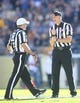 Oct 10, 2015; Pittsburgh, PA, USA; ACC official Larry Hayes (right) signals a holding penalty as referee Duane Heydt (left) looks on in the game between the Virginia Cavaliers and the Pittsburgh Panthersduring the third quarter at Heinz Field. PITT won 26-19. Mandatory Credit: Charles LeClaire-USA TODAY Sports