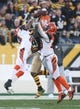 Nov 1, 2015; Pittsburgh, PA, USA; Cincinnati Bengals cornerback Adam Jones (24) and free safety Reggie Nelson (20) break up a pass intended for Pittsburgh Steelers wide receiver Antonio Brown (84) during the second quarter at Heinz Field. Mandatory Credit: Charles LeClaire-USA TODAY Sports