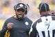Nov 1, 2015; Pittsburgh, PA, USA; Pittsburgh Steelers head coach Mike Tomlin (L) reacts on the sidelines as he talks to side judge Keith Washington (7) against the Cincinnati Bengals during the third quarter at Heinz Field. The Bengals won 16-10.Mandatory Credit: Charles LeClaire-USA TODAY Sports