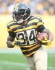 Nov 1, 2015; Pittsburgh, PA, USA; Pittsburgh Steelers running back DeAngelo Williams (34) runs the ball against the Cincinnati Bengals during the third quarter at Heinz Field. The Bengals won 16-10. Mandatory Credit: Charles LeClaire-USA TODAY Sports