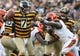 Nov 1, 2015; Pittsburgh, PA, USA; Pittsburgh Steelers quarterback Ben Roethlisberger (7) throws a pass under pressure from Cincinnati Bengals defensive end Wallace Gilberry (95) during the second half at Heinz Field. The Bengals won the game 16-10. Mandatory Credit: Jason Bridge-USA TODAY Sports