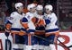 Nov 5, 2015; Montreal, Quebec, CAN; New York Islanders forward Kyle Okposo (21) celebrates with teammates including John Tavares (91) and Anders Lee (27) after scoring a goal against the Montreal Canadiens during the second period at the Bell Centre. Mandatory Credit: Eric Bolte-USA TODAY Sports