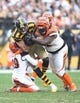 Nov 1, 2015; Pittsburgh, PA, USA; Pittsburgh Steelers tight end Matt Spaeth (89) is tackled after a catch by Cincinnati Bengals strong safety Leon Hall (29) and defensive tackle Pat Sims (92) during the third quarter at Heinz Field. The Bengals won 16-10. Mandatory Credit: Charles LeClaire-USA TODAY Sports