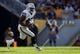 Nov 8, 2015; Pittsburgh, PA, USA; Oakland Raiders fullback Marcel Reece (45) runs with the ball against the Pittsburgh Steelers during the first quarter at Heinz Field. Mandatory Credit: Charles LeClaire-USA TODAY Sports