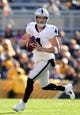 Nov 8, 2015; Pittsburgh, PA, USA; Oakland Raiders quarterback Derek Carr (4) looks to pass against the Pittsburgh Steelers during the first quarter at Heinz Field. Mandatory Credit: Charles LeClaire-USA TODAY Sports