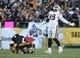Nov 8, 2015; Pittsburgh, PA, USA; Oakland Raiders linebacker Aldon Smith (99) celebrates a sack as Pittsburgh Steelers quarterback Ben Roethlisberger (7) lays injured on the ground during the second half at Heinz Field. The Steelers won the game, 38-35. Mandatory Credit: Jason Bridge-USA TODAY Sports