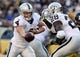 Nov 8, 2015; Pittsburgh, PA, USA; Oakland Raiders quarterback Derek Carr (4) hands the ball off to running back Latavius Murray (28) against the Pittsburgh Steelers during the second half at Heinz Field. The Steelers won the game, 38-35. Mandatory Credit: Jason Bridge-USA TODAY Sports