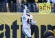 Nov 8, 2015; Pittsburgh, PA, USA; Oakland Raiders running back Jamize Olawale (49) celebrates his touchdown against the Pittsburgh Steelers during the second half at Heinz Field. The Steelers won the game, 38-35. Mandatory Credit: Jason Bridge-USA TODAY Sports