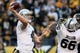 Nov 8, 2015; Pittsburgh, PA, USA; Oakland Raiders quarterback Derek Carr (4) throws a pass against the Pittsburgh Steelers during the second half at Heinz Field. The Steelers won the game, 38-35. Mandatory Credit: Jason Bridge-USA TODAY Sports