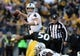 Nov 8, 2015; Pittsburgh, PA, USA; Oakland Raiders quarterback Derek Carr (4) throws a pass under pressure from Pittsburgh Steelers linebacker Ryan Shazier (50) during the second half at Heinz Field. The Steelers won the game, 38-35. Mandatory Credit: Jason Bridge-USA TODAY Sports