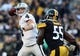 Nov 8, 2015; Pittsburgh, PA, USA; Oakland Raiders quarterback Derek Carr (4) throws a pass under pressure from Pittsburgh Steelers linebacker Arthur Moats (55) during the second half at Heinz Field. The Steelers won the game, 38-35. Mandatory Credit: Jason Bridge-USA TODAY Sports