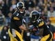Nov 8, 2015; Pittsburgh, PA, USA; Pittsburgh Steelers quarterback Landry Jones (3) hands the ball off to running back DeAngelo Williams (34) against the Oakland Raiders during the second half at Heinz Field. The Steelers won the game, 38-35. Mandatory Credit: Jason Bridge-USA TODAY Sports