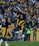 Nov 8, 2015; Pittsburgh, PA, USA; Pittsburgh Steelers tight end Jesse James (81) celebrates his touchdown with wide receiver Martavis Bryant (10) during the second half against the Oakland Raiders at Heinz Field. The Steelers won the game, 38-35. Mandatory Credit: Jason Bridge-USA TODAY Sports