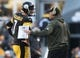 Nov 8, 2015; Pittsburgh, PA, USA; Pittsburgh Steelers quarterback Ben Roethlisberger (7) talks with offensive coordinator Todd Haley on the sidelines against the Oakland Raiders during the first half at Heinz Field. Mandatory Credit: Jason Bridge-USA TODAY Sports