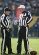 Nov 8, 2015; Pittsburgh, PA, USA; NFL umpire Paul King (left) and referee Bill Vinovich (52) talk during the game between the Oakland Raiders and the Pittsburgh Steelers during the second quarter at Heinz Field. The Steelers won 38-35. Mandatory Credit: Charles LeClaire-USA TODAY Sports