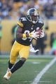 Nov 8, 2015; Pittsburgh, PA, USA; Pittsburgh Steelers wide receiver Antonio Brown (84) runs the ball against the Oakland Raiders during the second quarter at Heinz Field. The Steelers won 38-35. Mandatory Credit: Charles LeClaire-USA TODAY Sports