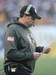 Nov 8, 2015; Pittsburgh, PA, USA; Pittsburgh Steelers offensive coordinator Todd Haley looks over his play chart against the Oakland Raiders during the third quarter at Heinz Field. The Steelers won 38-35. Mandatory Credit: Charles LeClaire-USA TODAY Sports