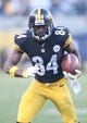 Nov 8, 2015; Pittsburgh, PA, USA; Pittsburgh Steelers wide receiver Antonio Brown (84) runs after a catch against the Oakland Raiders during the fourth quarter at Heinz Field. The Steelers won 38-35. Mandatory Credit: Charles LeClaire-USA TODAY Sports