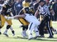 Nov 21, 2015; Iowa City, IA, USA; Iowa Hawkeyes quarterback C.J. Beathard (16) is hit by Purdue Boilermakers linebacker Jimmy Herman (29) in the second quarter at Kinnick Stadium. Mandatory Credit: Reese Strickland-USA TODAY Sports