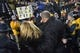 Nov 21, 2015; Columbia, MO, USA; Missouri Tigers head coach Gary Pinkel leaves the field with wife Missy Martinette after the game against the Tennessee Volunteers at Faurot Field. Tennessee won the game 19-8. Mandatory Credit: Denny Medley-USA TODAY Sports