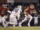 Nov 21, 2015; Norman, OK, USA; Oklahoma Sooners quarterback Trevor Knight (9) runs with the ball as TCU Horned Frogs safety Derrick Kindred (26) defends during the second half at Gaylord Family - Oklahoma Memorial Stadium. Mandatory Credit: Kevin Jairaj-USA TODAY Sports