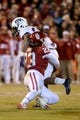 Nov 21, 2015; Norman, OK, USA; TCU Horned Frogs running back Aaron Green (22) is tackled by Oklahoma Sooners linebacker Devante Bond (23) during the fourth quarter at Gaylord Family - Oklahoma Memorial Stadium. Mandatory Credit: Mark D. Smith-USA TODAY Sports