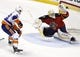 Nov 27, 2015; Sunrise, FL, USA; Florida Panthers goalie Roberto Luongo (1) makes a save against New York Islanders center Brock Nelson (29) in the third period at BB&T Center. Mandatory Credit: Robert Mayer-USA TODAY Sports