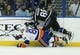 Nov 28, 2015; Tampa, FL, USA; Tampa Bay Lightning right wing Nikita Kucherov (86) and New York Islanders center Mikhail Grabovski (84) collide going for a loose puck during the first period at Amalie Arena. Mandatory Credit: Reinhold Matay-USA TODAY Sports