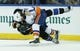 Nov 28, 2015; Tampa, FL, USA;New York Islanders left wing Matt Martin (17) and Tampa Bay Lightning defenseman Braydon Coburn (55) fight during the second period at Amalie Arena. Mandatory Credit: Reinhold Matay-USA TODAY Sports