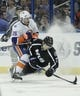 Nov 28, 2015; Tampa, FL, USA; Tampa Bay Lightning defenseman Victor Hedman (77) and New York Islanders right wing Cal Clutterbuck (15) collide during the third period of a hockey game at Amalie Arena.The Islanders won 3-2. Mandatory Credit: Reinhold Matay-USA TODAY Sports