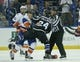 Nov 28, 2015; Tampa, FL, USA; NHL Linesman Jonny Murray (95) tries to break up a fight between New York Islanders right wing Kyle Okposo (21) and Tampa Bay Lightning right wing Ryan Callahan (24) during the first period at Amalie Arena. Mandatory Credit: Reinhold Matay-USA TODAY Sports