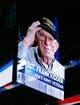 Nov 28, 2015; Tampa, FL, USA; World War II Army veteran Sgt. Frank Kidder is honored on the jumbotron before a hockey game between the Tampa Bay Lightning and the New York Islanders at Amalie Arena. Mandatory Credit: Reinhold Matay-USA TODAY Sports