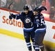Dec 15, 2015; Winnipeg, Manitoba, CAN;  Winnipeg Jets right wing Drew Stafford (12) celebrates his goal during the second period against the St. Louis Blues at MTS Centre. Mandatory Credit: Bruce Fedyck-USA TODAY Sports