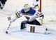 Dec 15, 2015; Winnipeg, Manitoba, CAN;  St. Louis Blues goalie Jake Allen (34) makes a save during the second period against the Winnipeg Jets at MTS Centre. Mandatory Credit: Bruce Fedyck-USA TODAY Sports